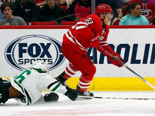 Carolina Hurricanes' Jeff Skinner (53) breaks away from Dallas Stars' Gemel Smith (46) during the first period of an NHL hockey game, Saturday, April 1, 2017, in Raleigh, N.C. (AP Photo/Karl B DeBlaker)