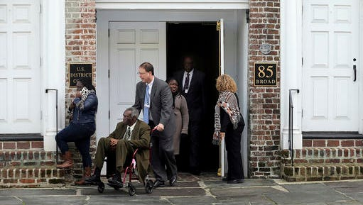 The Rev. Spike Coleman pushes John Pinckney, father of the Rev. Clementa Pinckney, one of the Emanuel Church shooting victims, as they leave  leaves the U.S. District Court on Tuesday, Jan. 10, 2017, in Charleston, S.C.