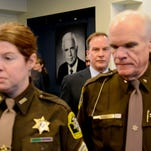 Michigan Attorney General Bill Schuette, preceded by Ingham County Sheriff Gene Wriggelsworth and Ingham County Det. Amber Kenny-Hinojosa, enter the room where he held a press conference Monday, March 14, 2016, to discuss charges against Ingham County Prosecutor Stuart Dunnings III. Dunnings is charged with 15 criminal charges in Ingham, Clinton and Ionia counties including pandering and engaging in services of prostitutes.