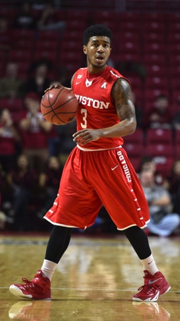 Houston Cougars guard Ronnie Johnson (3) looks on against the Temple Owls during the first half at Liacouras Center. Houston won 77-50 on Jan 2, 2016.