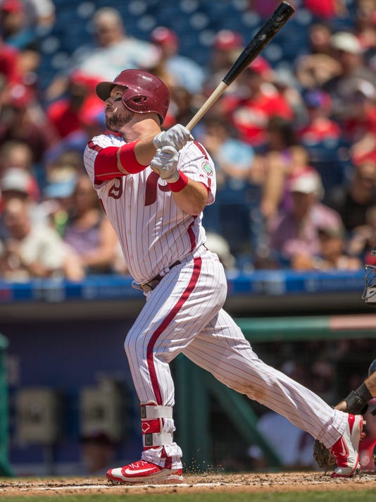 Philadelphia Phillies' Cameron Rupp follows through on a home run off a pitch from San Diego Padres starter Trevor Cahill in the second inning of a baseball game, Sunday, July 9, 2017, in Philadelphia. (AP Photo/Laurence Kesterson)