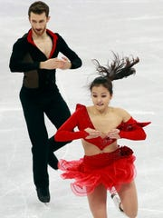 Yura Min's costume top dropped dangerously low several times during her perfomance with Alexander Gamelin.