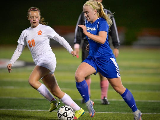 Sartell's Bria Ferns drives the ball past St. Cloud Tech's Maddie Davidson in the first half Sept. 27 at Husky Stadium.