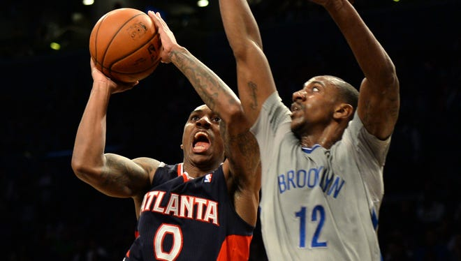 Atlanta Hawks Jeff Teague (L) drives on Brooklyn Nets Marquis Teague during their NBA game on April 11, 2014 at the Barclay Center in New York.