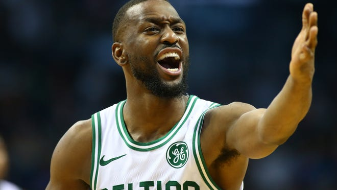 Boston Celtics guard Kemba Walker (8) yells at the bench during the first half against the Charlotte Hornets at Spectrum Center on Nov. 7, 2019.