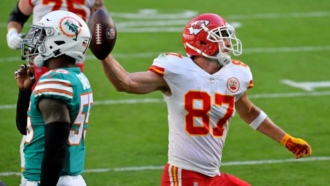 Kansas City Chiefs tight end Travis Kelce, right, spikes the ball after scoring a touchdown against the Miami Dolphins during the first half Sunday afternoon at Hard Rock Stadium in Miami Gardens, Fla.