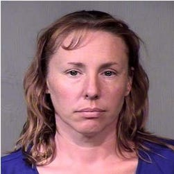 Michelle Dawn Gibson, 43, is on trial in Maricopa County (Ariz.) Court, accused of plotting to murder her husband, whom she said was abusive.