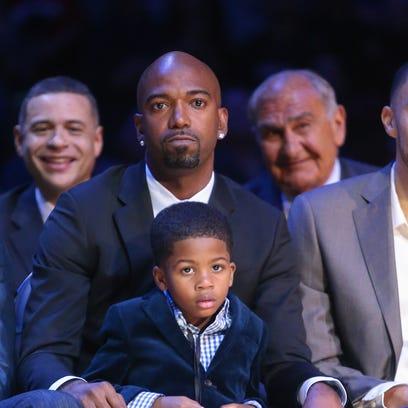 Former Pistons guard Richard Hamilton and his son,