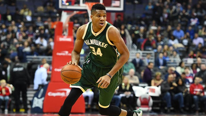 Milwaukee Bucks forward Giannis Antetokounmpo (34) dribbles against the Washington Wizards during the first half at Verizon Center.