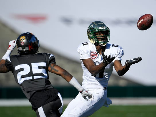American team's Marquez Valdes-Scantling, of South Florida, catches a pass as National team's Henre' Toliver, of Arkansas, defends during the first half of the Collegiate Bowl college football game, Saturday, Jan. 20, 2018, in Pasadena, Calif. (AP Photo/Mark J. Terrill)