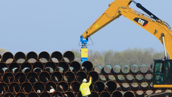 Workers stack pipes for the Dakota Access Pipeline, which traverses North Dakota, South Dakota Iowa and part of Illinois, on May 9, 2015. On Oct. 22, 2019, Lincoln County commissioners approved a pumping station that will help double the amount of oil pumped into the pipeline.