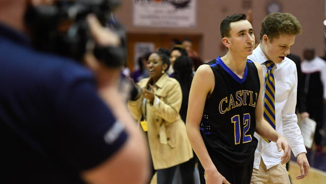 Castle's Alex Hemenway (right) leaves the court after loosing to Ben Davis 74-71 in the Boys' Semi-State Basketball Tourney at Seymour High School Saturday, March 18, 2017.