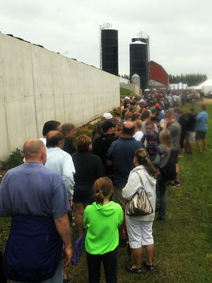 At its peak about 10:30 a.m., a long line leads to the ticket area (striped tent near the silos) for the Dairy Breakfast on Sunday at the Haberli Family Farms, West Jacksonport. The Sevastopol FFA Alumni was expecting to break an attendance record.