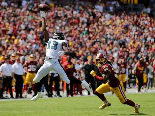 Philadelphia Eagles wide receiver Nelson Agholor, left, makes a catch in front of Washington Redskins free safety D.J. Swearinger in the first half of an NFL football game, Sunday, Sept. 10, 2017, in Landover, Md. (AP Photo/Mark Tenally)