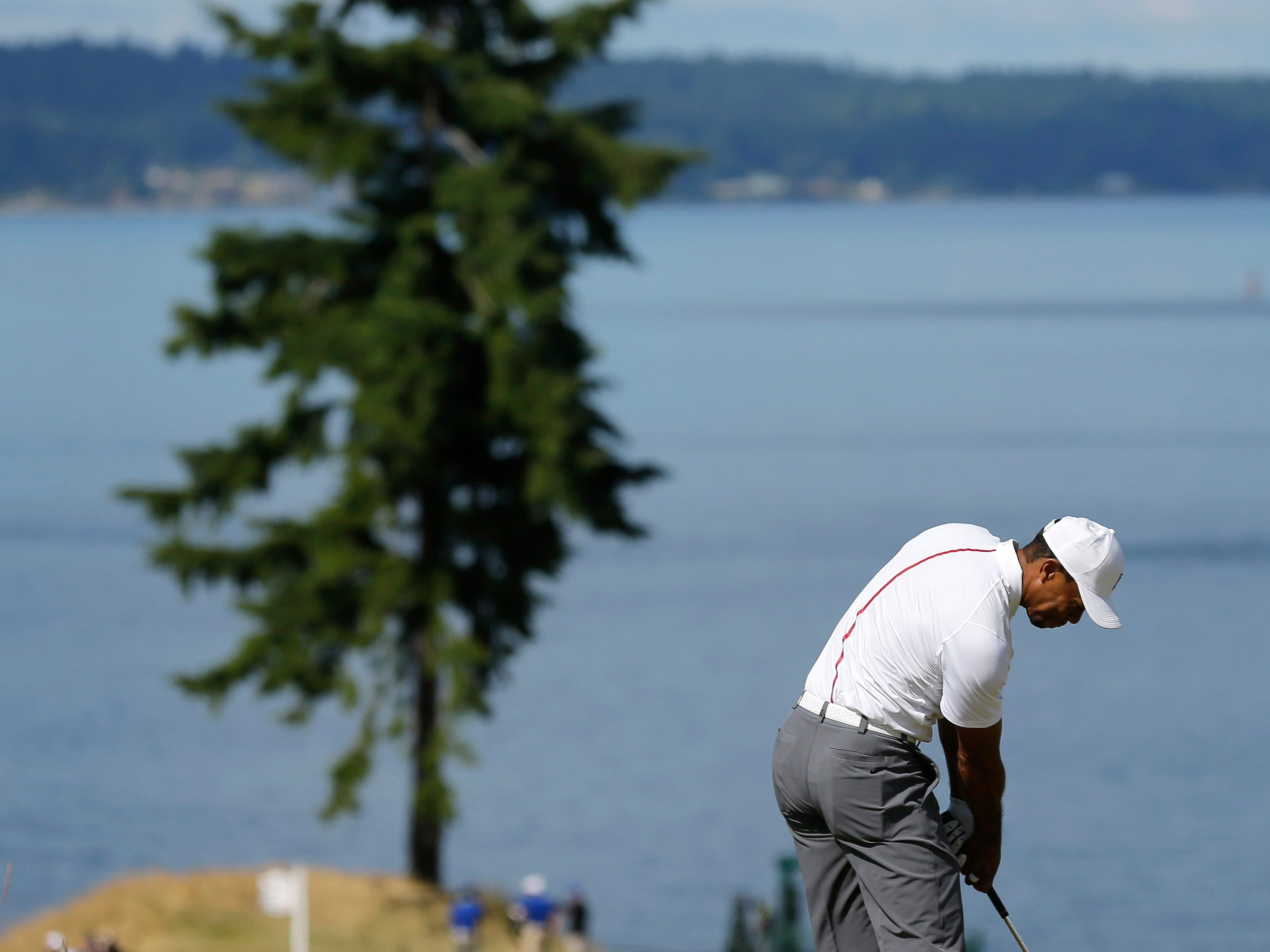 Tiger Woods hits to the 15th hole during the second round of the U.S. Open golf tournament at Chambers Bay on Friday, June 19, 2015 in University Place, Wash. (AP Photo/Ted S. Warren)