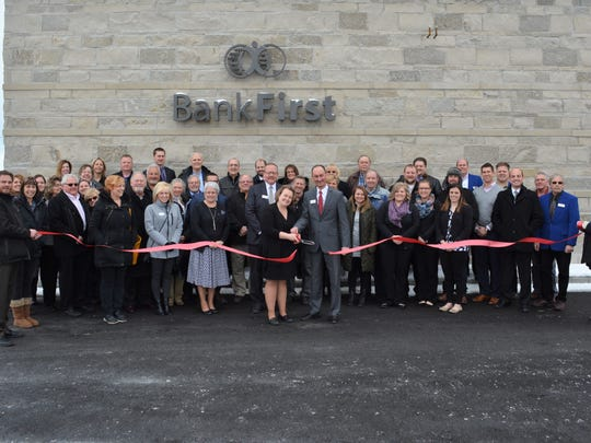 Bank Firstheld a ribbon-cutting ceremony on Feb. 13 to celebrate the grand opening of its new location in Plymouth.