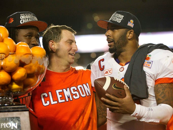 Clemson quarterback Tajh Boyd and coach Dabo Swinney celebrate after defeating Ohio State 40-35 to win the Orange Bowl in Miami Gardens, Fla.