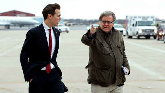 Jared Kushner, son in-law of President Trump, left, walks with Stephen Bannon at Indianapolis International Airport on Dec. 1, 2016.