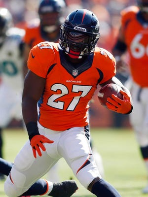 Knowshon Moreno rushed for three TDs to help the Broncos remain unbeaten.