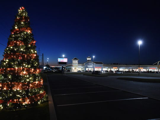 Dawn breaks over the stores at the Midway Outlets as Black Friday has come to Tanger Outlets in Rehoboth Beach and Lewes as thousands of shoppers have descended on the Outlet Centers to hunt for bargains and start their Holiday Shopping.