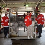 Detroit Red Wings Daniel Cleary, Henrik Zetterberg and Johan Franzen pose on a fire engine at the Detroit Fire Department, Engine 27 on day one of the Red Wings Community Tour on Tuesday, September 16, 2014.