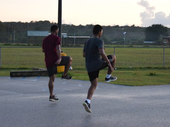 The FAS track and field team warm up at their practice on Wednesday, Sept. 6 at the Guam Sports Complex Field in Dededo.