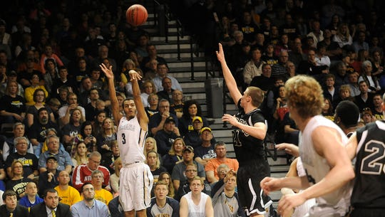 Augustana's #3 John Warren shoots against Harding during