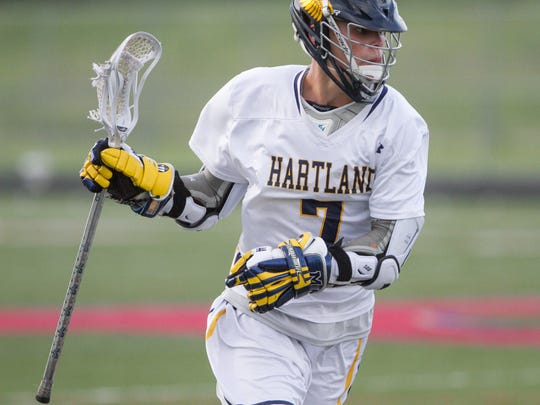 Hartland's Reece Potter had five goals and four assists in a 21-5 victory over Howell in a regional championship lacrosse game on Wednesday, May 30, 2018.
