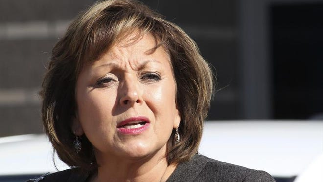 In this Aug. 18, 2016, file photo, New Mexico Gov. Susana Martinez speaks during a news conference in Albuquerque, N.M. The nation's only Latina governor is denouncing a charge by a white former mayor of Santa Fe, N.M., that she is a racist.