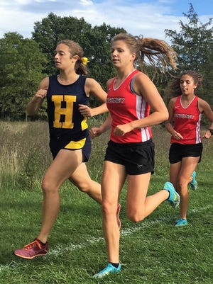 Hartland's Michelle Moraitis (left) was a three-time state qualifier in cross country.