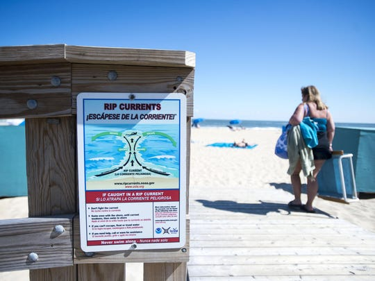 A rip current sign warns beachgoers in Ocean City. Pay attention to signs like this.