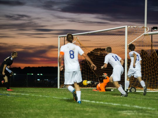 Decatur goal keeper David Garcia narrowly blocks a shot on goal against Northeast Friday, Oct. 24 in Berlin. The Seahawks won 2-1, advancing to Tuesday's sectional semifinals.