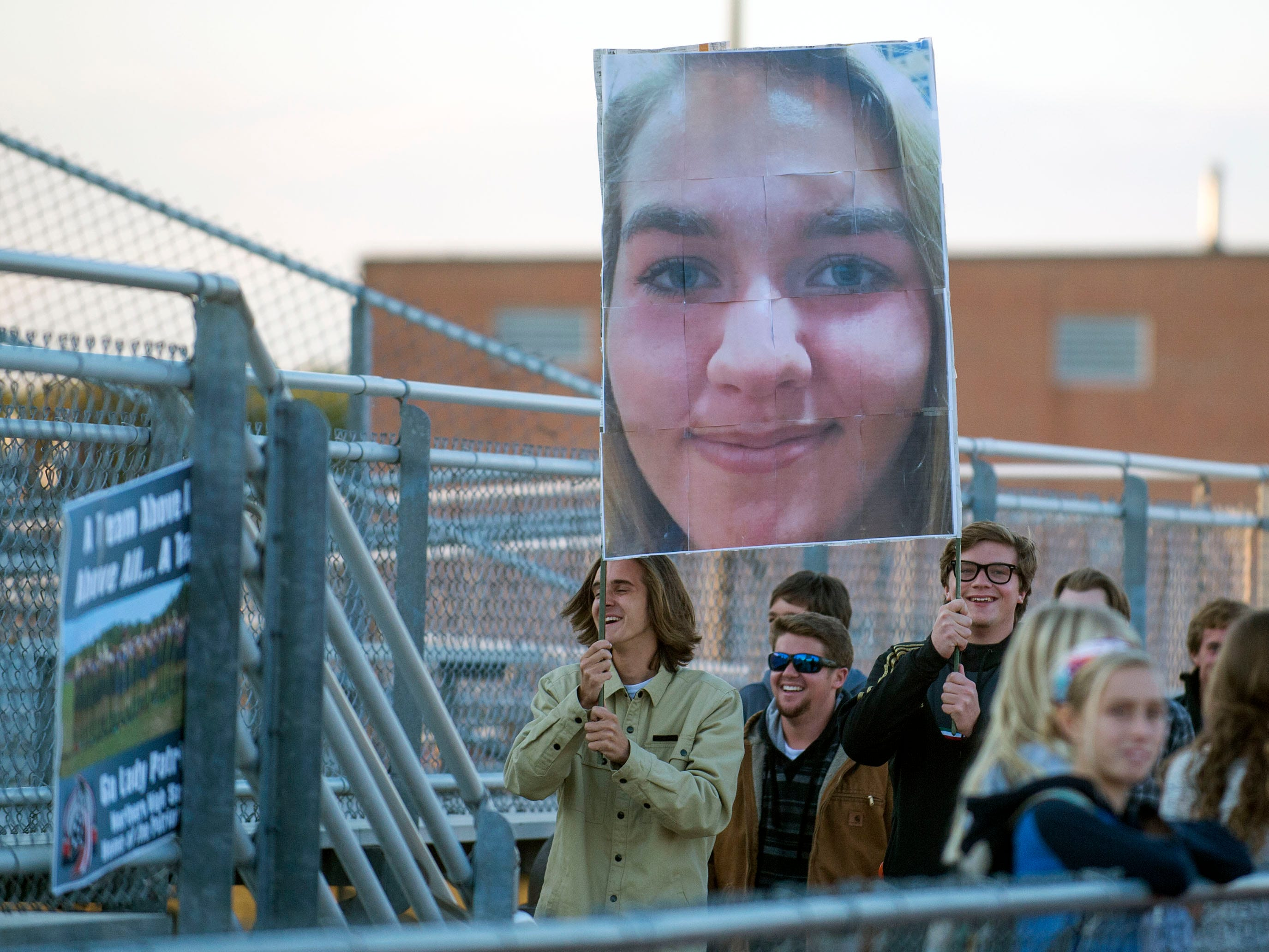 Students walk into Seahawks stadium with a giant banner featuring team captain Jillian Petito's face blown up as Decatur takes takes on Northern Thursday night in Berlin.