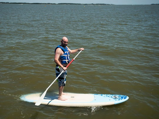 Participants compete in a stand up paddle board race at Holts Landing State Park on the Indian River Bay in Millville.