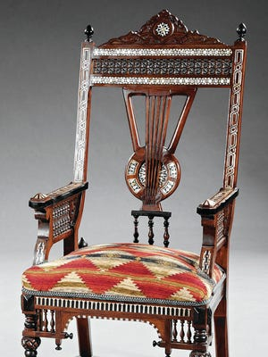 This unusual chair is one of a pair of Moorish chairs offered in a recent auction. The design was inspired by furniture from many countries and would make a good accent piece in a plain modern room.