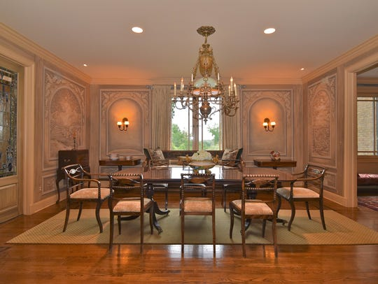 The dining room has recessed lights to supplement the