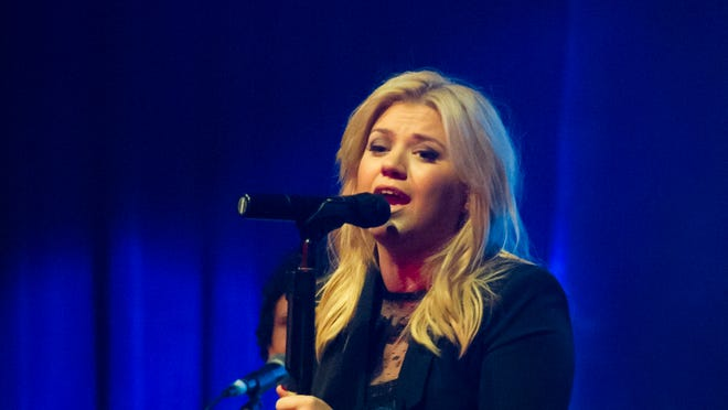 Kelly Clarkson performs at a concert  in New York.