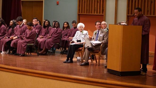 Student Scholar Leclerson Simeus (Neptune High School) at podium.