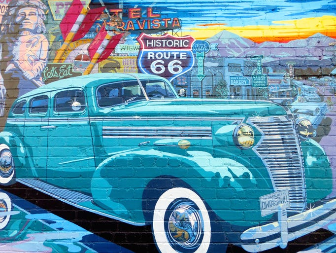 A colorful mural of the Mother Road is painted on a