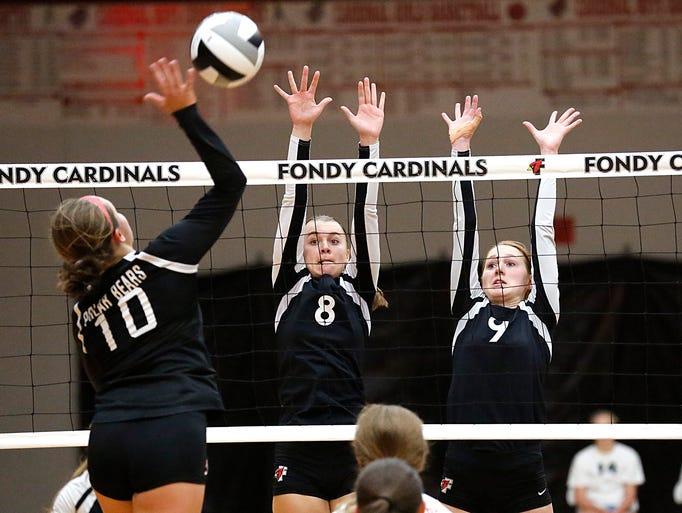 Fond du Lac girls volleyball players Megan and Lauren