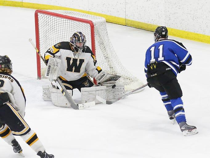 Waupun High School Hockey's Caleb Sauer blocks a score