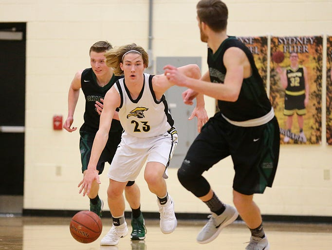 Waupun High School boys basketball's Reece Homan breaks