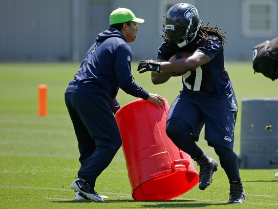 Seattle Seahawks running back Eddie Lacy (right) takes