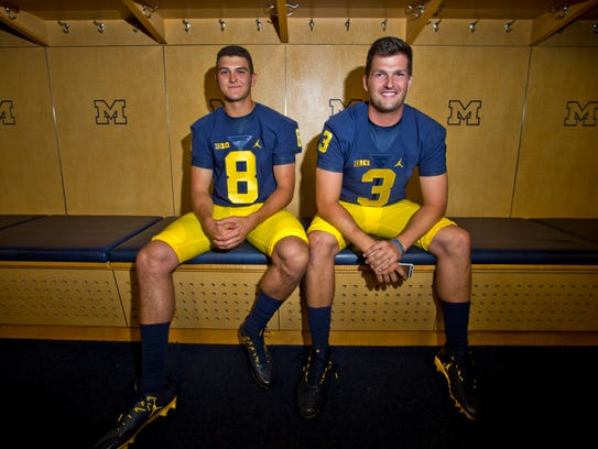 Michigan is counting on  John O'Korn (8) and Wilton