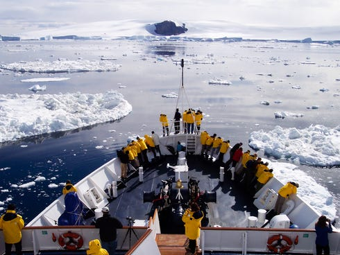 Guests on a Quark Expedition cruise get their first glimpse of the coast of Antarctica.