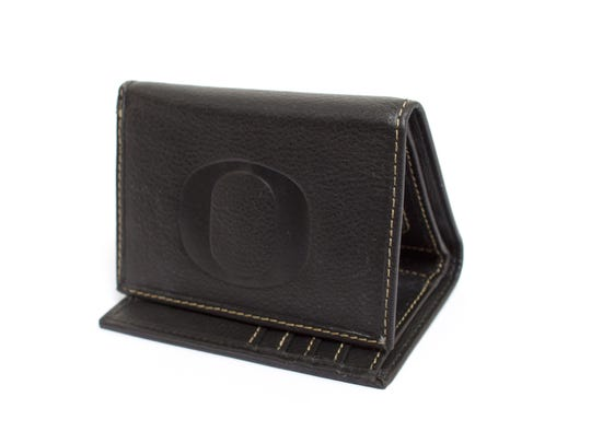 Genuine leather wallet is embossed with the Oregon O logo, $24. uoduckstore.com.