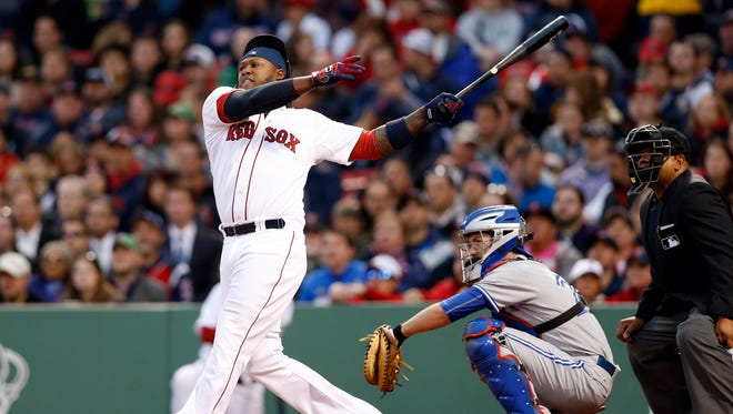 Hanley Ramirez hits a two-run home run off Blue Jays pitcher R.A. Dickey during the third inning at Fenway Park.