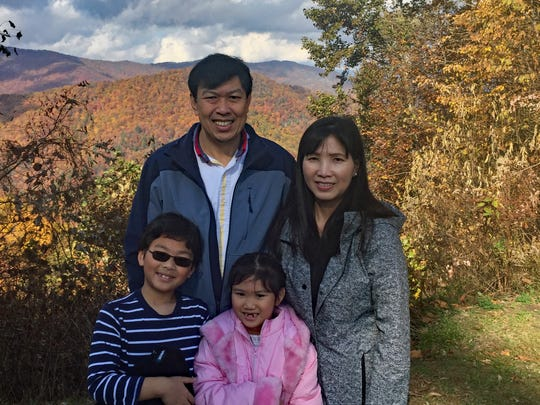 Christopher Siv and his wife, Chuong, pose with their two children.