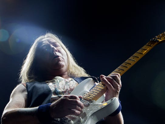 Iron Maiden guitarist Dave Murray performs during the