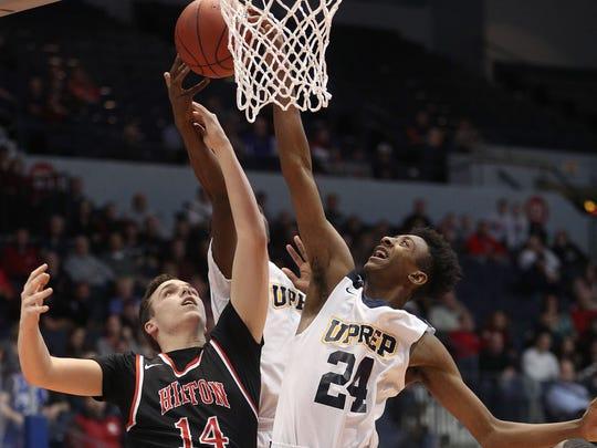 UPrep's Zach Harris Scott (24) and Hilton's Mitchell Carr battle for a rebound.